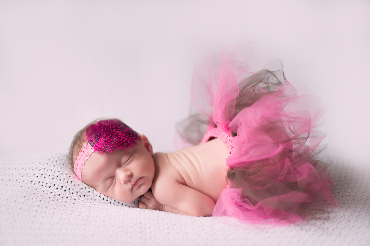 Baby girl wearing a tutu sleeping by Greenville SC Newborn Photographer Elizabeth and Charles.