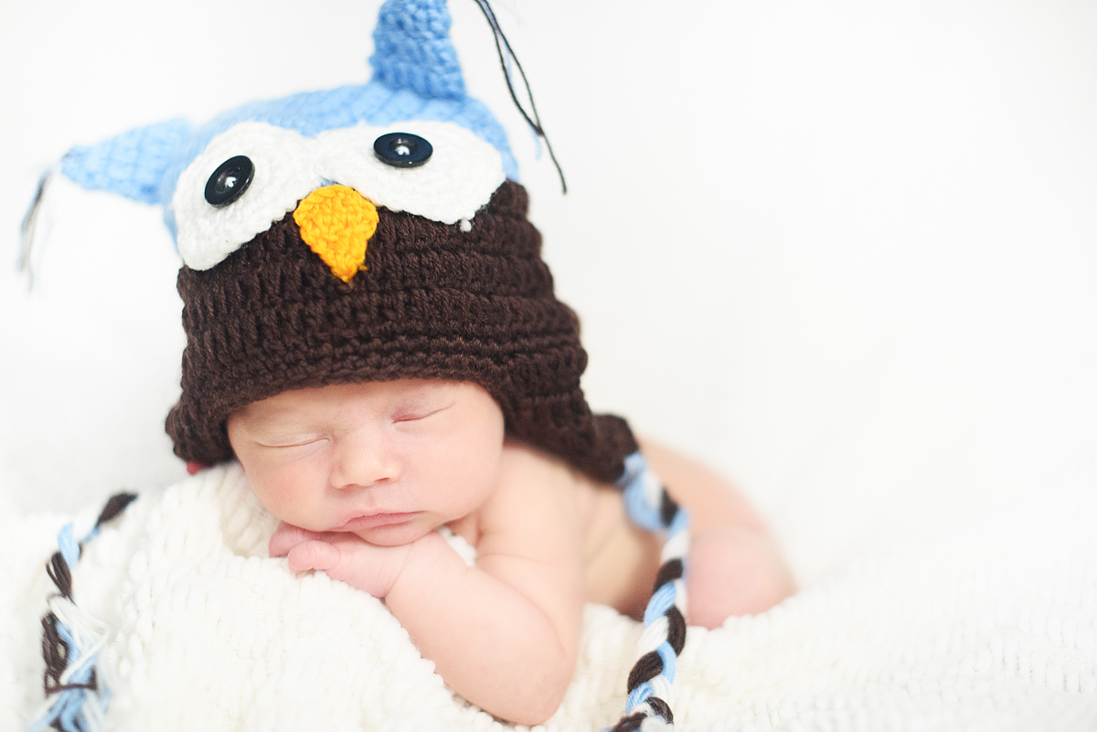 Baby boy wearing a knitted owl hat by Greenville SC Newborn Photographer Elizabeth and Charles.
